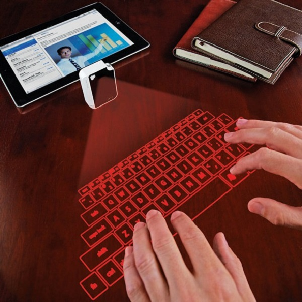 796246p This Small laser projecting keyboard can connect to your smartphone and desktops